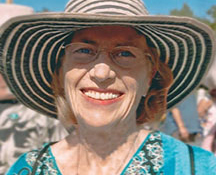 old lady with sun hat smiling