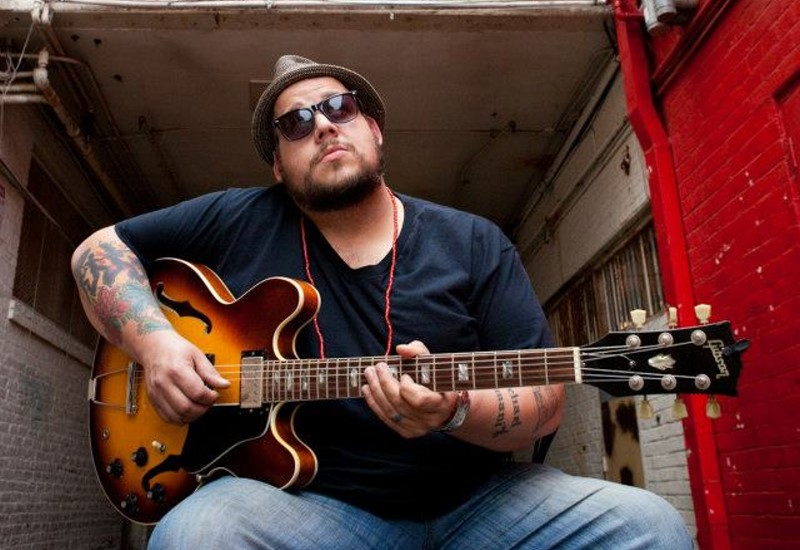 gino mateo playing guitar
